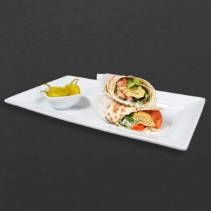 Chicken koobideh wrap with lettuce, tomato, lavash, and hot peppers on the side.