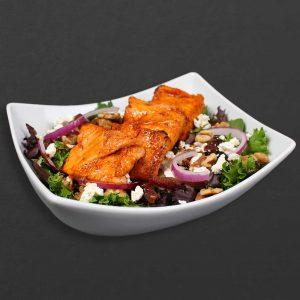 Salmon on top of kebab bar salad.