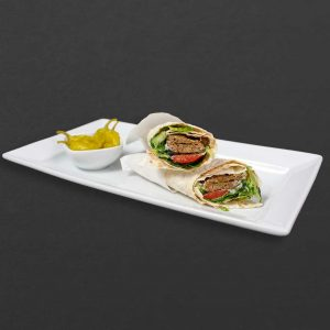 Beef koobideh wrap with lettuce, tomato, lavash, and hot peppers on the side.