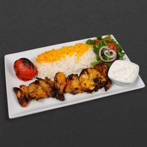 Cornish hen plate with rice, tomato, salad, and yogurt.