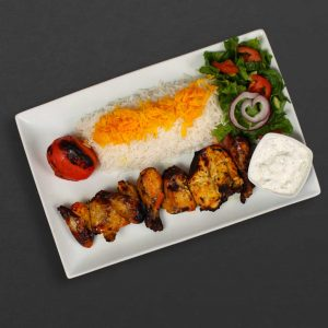 Cornish Chicken Kebab Plate with rice, tomato, salad, and maust o khiar.