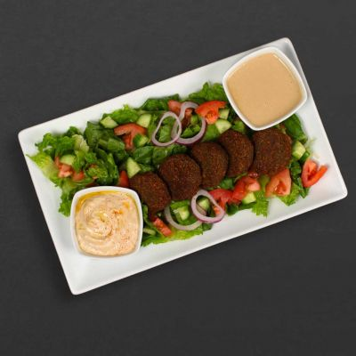 Felafel Plate with salad, hummus, and tahini sauce.