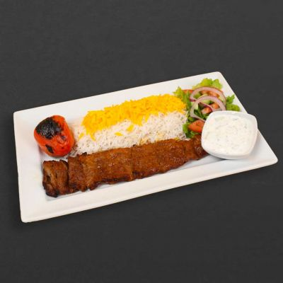 Kebab barg plate with rice, salad, and tomato.