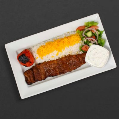 Kabab Barg plate with rice, tomato, salad, and maust o khiar.