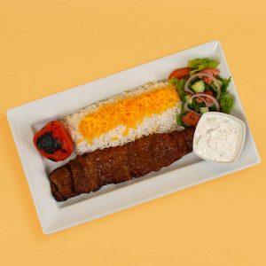 Kabab Barg plate with rice, tomato, salad, and maust o khiar.