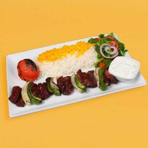 Shish kebab plate with rice, tomato, salad, and maust o khiar.