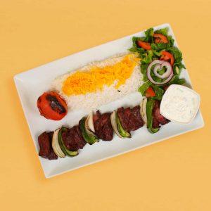 Shish kebab plate with tomato, rice, salad, and maust o khiar.